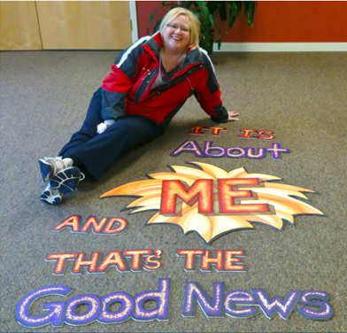 Meg with a sign she created for one of our seminars.