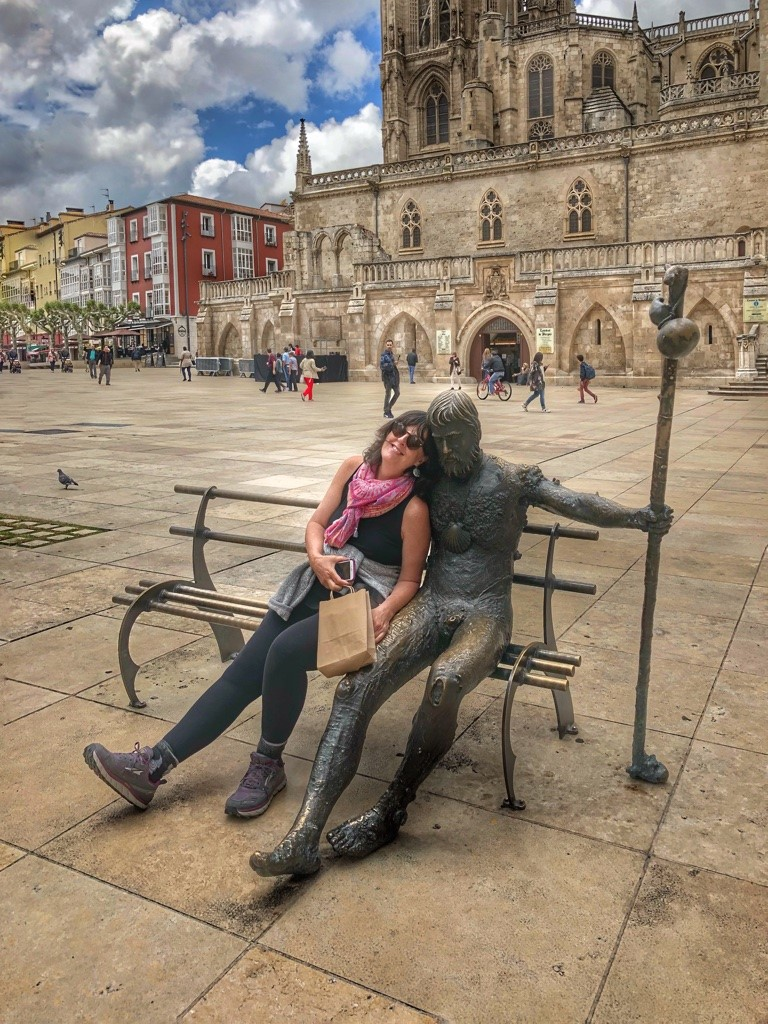 Posing with the statue of the weary pilgrim in Burgos, my first day back on the Camino after five days in bed with the flu. (Photo by Tiera St. Clair)
